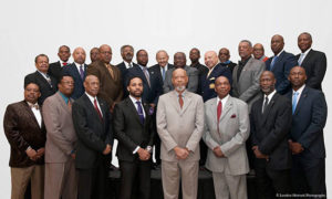 Leader of 100 Black Men Standing and posing for a picture